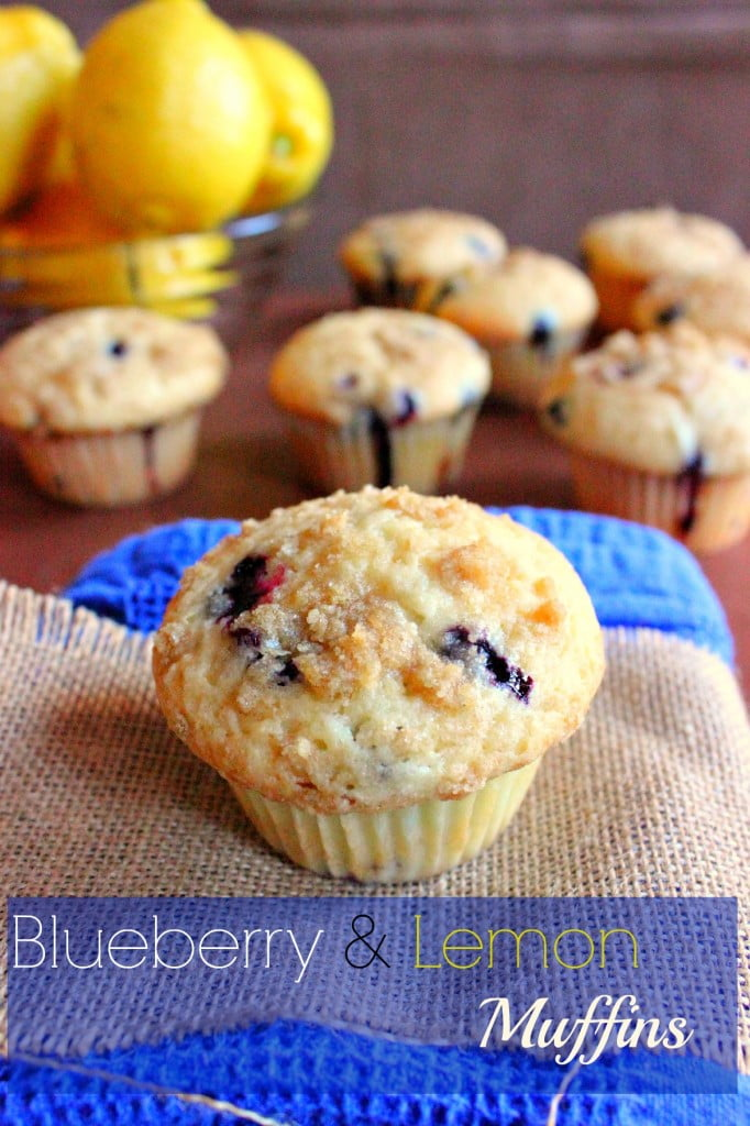 blueberry and lemon muffins with a bowl of lemons in the background