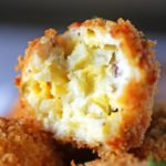 Fried balls made with turkey, mashed potatoes, stuffing, and coated in panko crumbs fried.