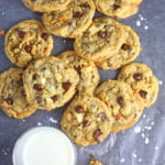 a cooling rack with snack time cookies and a glass of milk