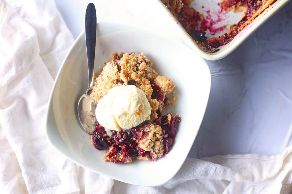 Super Simple Cherry Crumble in a bowl with ice cream